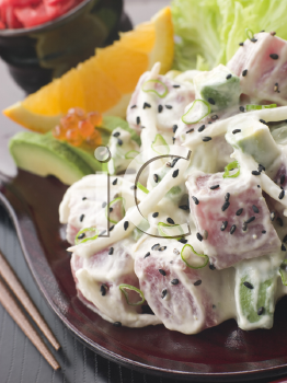 Royalty Free Photo of Sashimi Tuna and Wasabi Salad With Avocado and Red Pickled Ginger