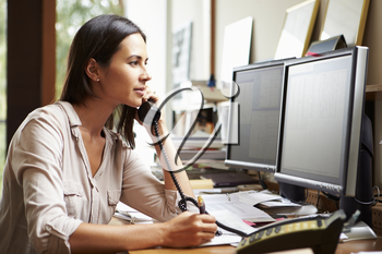 Female Architect Working At Desk On Computer