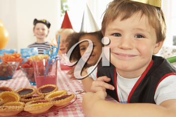 Young children eating at birthday party