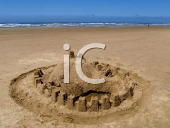 Royalty Free Photo of a Sand Castle on the Ocean Beach