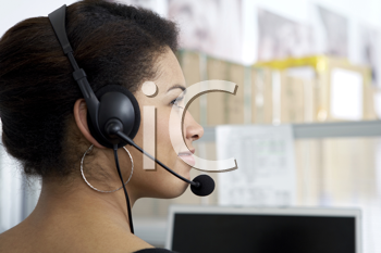 Royalty Free Photo of a Woman Talking on a Headset