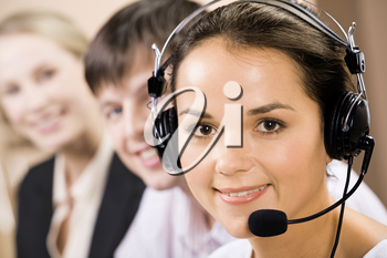 Portrait of friendly telephone operator with headset