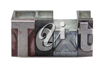The word Text in old letterpress printing blocks isolated on a white background.
