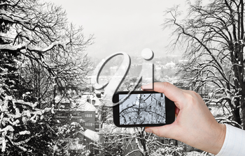 travel concept - tourist taking photo of Zurich city skyline in winter on mobile gadget, Switzerland