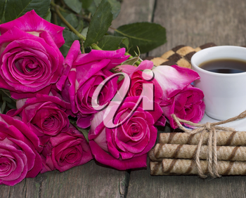 bouquet of red roses and coffee close-up