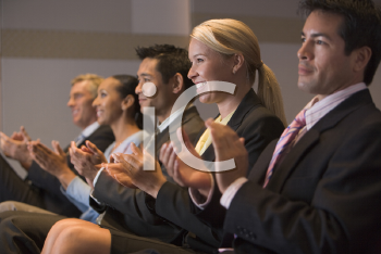 Royalty Free Photo of People Applauding in a Presentation