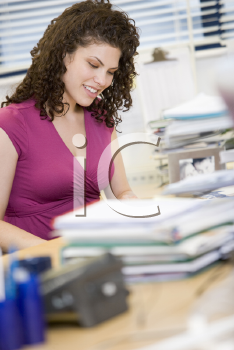 Royalty Free Photo of a Woman Working at Her Desk