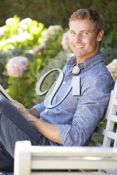 Man reading in garden