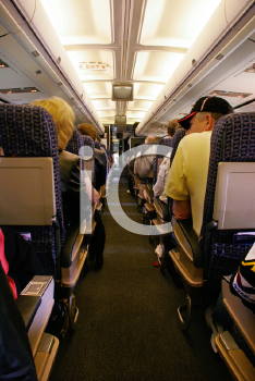 Royalty Free Photo of People on a Plane