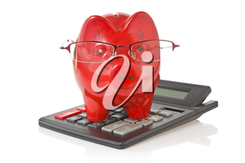 calculator and piggy-bank with glasses  on white background