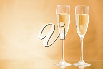 Horizontal image of two champagne standing on the table